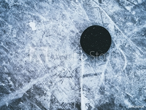 Bild på hockey puck on the ice and snow texture, copyspace and text